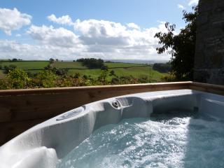 Soak up the amazing countryside views from the private hot tub