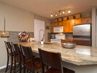 New modern kitchen, oversized stone island with 4 Chairs