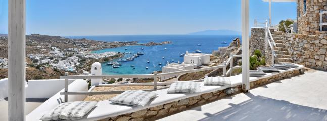 The spacious terrace offers the best view to psarrou beach