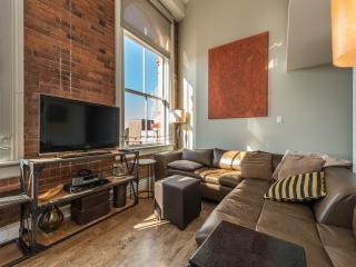 Living area with building's original brick exterior