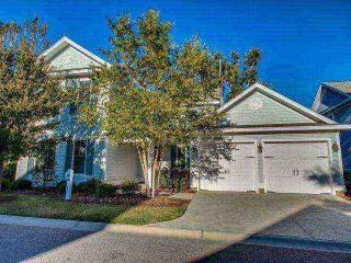 Luxury North Beach Plantation 4 BR4.5 BA Cottage Sleeps 12. 2.5 Acres of Pools, North Myrtle Beach