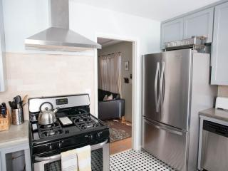 Overhead vent with new oven and dishwasher