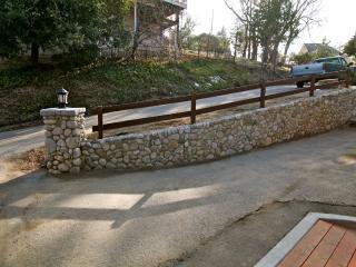 River rock retaining wall at driveway