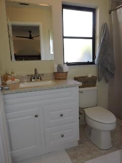 Master bath with a walk in shower