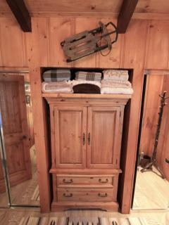 Flatscreen TV, DVD & VCR are located inside of cabinet that sits in front of queen size bed.