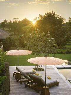 Puri Bawana - Pool chairs at sunset