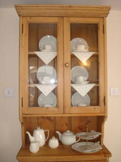 Welsh Dresser with crockery to enjoy an afternoon tea at poolside or in the cosy lounge