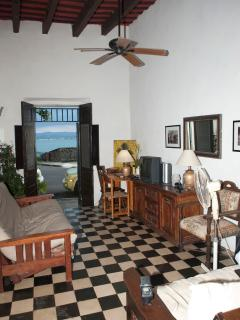 Living room with bay and Old City wall in background