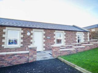 HOME STEAD COTTAGE, all ground floor, woodburner, parking, garden, in Embleton