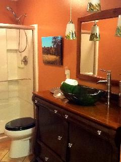 First floor full bath with Kohler fixtures & antique buffet for counter.