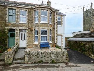 HILLVIEW COTTAGE, semi-detached, open fire, private garden, play room, WiFi