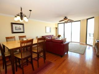 Dining area situated between kitchen and living room