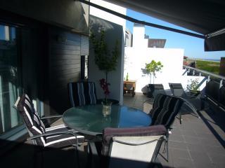Atico en Llanes con dos habitaciones y gran terraz