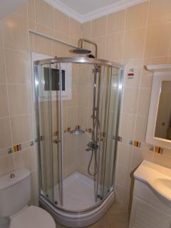 double bedroom bathroom with rain shower