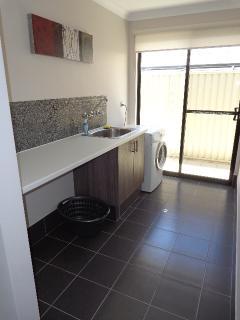 laundry with washing machine iron and ironingboard