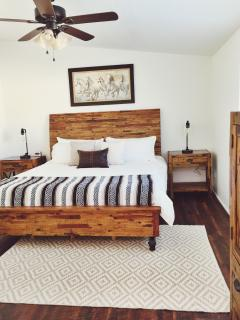 Luxurious king bed in the master suite with a memory foam mattress