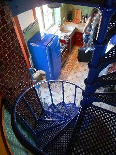 Spiral staircase to kitchen