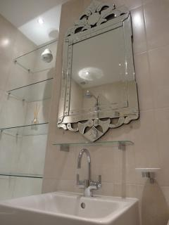 Art deco  style bathroom with venetian mirror