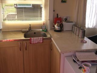 Kitchen area upon entrance into chalet, microwave, fridge etc....
