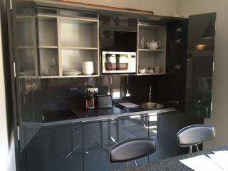 The hidden kitchen with Quooker tap, dishwasher and induction hob.