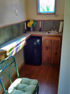 kitchen with microwave,toaster,coffee maker, outside gas grill.