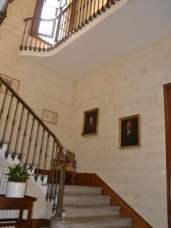 spectacular staircase and paintings