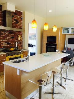 Gourmet kitchen with all the amenities ie 2 ovens,large island/sink seating 5,TV,VitaMix,oils.