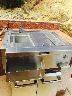 Barbecue sink and condiment bar with the accessories.