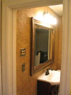 Tile bathroom has plenty of fluffy towels, shampoo, conditioner and a good hair dryer.