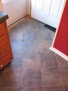 kitchen has custom tile floor and a 2nd side porch entrance.