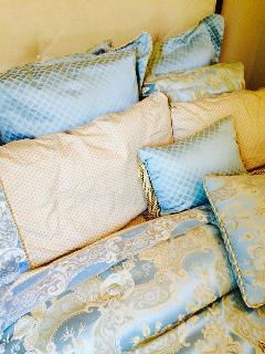 Queen Bedding is high quality. Bedrooms separated by a hall, closet and restroom for added privacy.