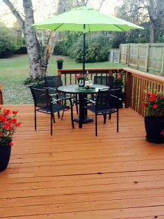 Large deck with Grill overlooks private, fenced yard and garden with birds, squirrels and trees