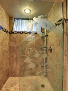 One of a kind custom etching by Hawaiian Artist.  The shower/tub  removed to make this large Shower