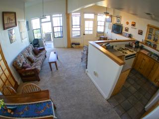 Full kitchen, Dining Room & Living Room with doors leading out to balcony