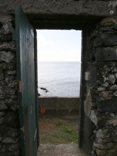 Door to the ocean side and natural pools.