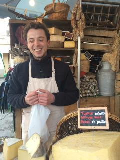 A charming cheese merchant at the market!