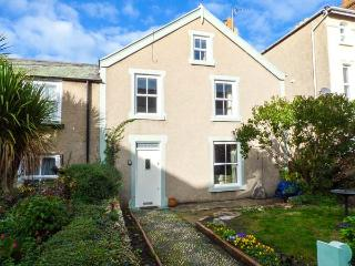 TREVOR COTTAGE, terraced, woodburner, enclosed front and rear gardens, in