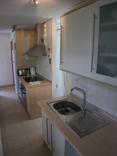 Kitchen, complete with hob, oven, microwave, kettle, toaster, utensils etc