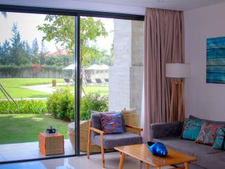 The living room views over a beautiful green garden. The huge 5-pool complex is a few steps away.