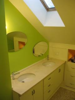 Double sinks, large skylight, storage.