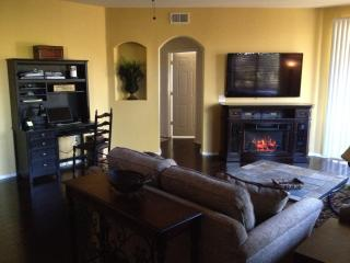 Living room with desk, free Wi-Fi,  electric fireplace with heater, 60' Vizio Smart HDTV, patio view