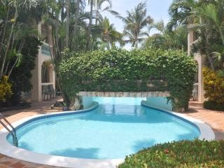 WALK OUT TO POOL AND GARDEN AREA