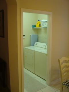 Laundry room with washer/dryer, ironing board and iron.