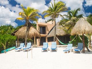 Casa Gray Put your toes in the water, **** in the sand.  Relax in the hammock