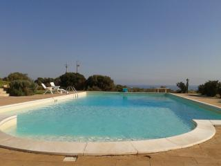 Swimming pool and view of sea