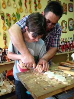 Gabriel getting a lesson in carving from a local artisan in VT.