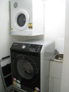 Laundry with Samsung large washer-dryer combo and separate dryer