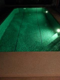 Swimmingpool by night with 2 underwater LED's with 18 programs (green color)