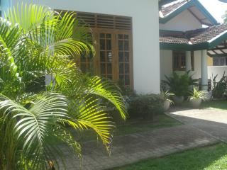 House side view from pool entrance.