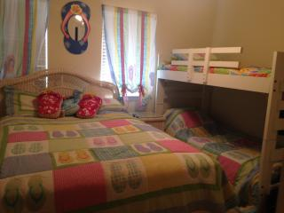 2nd bedroom with queen bed and twin bunk beds and full bathroom attached